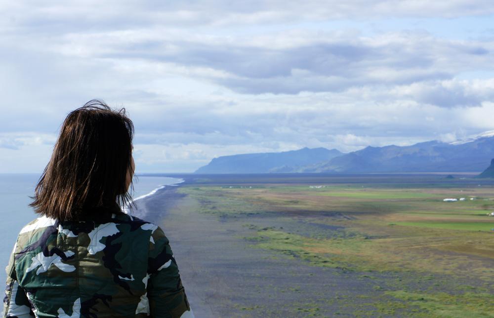 Dyrholaey & Reynisfjara black beach sea Iceland girl