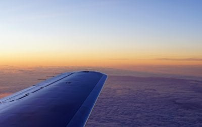 above the clouds plane wing in the sky private jet sunset облака закат над облаками
